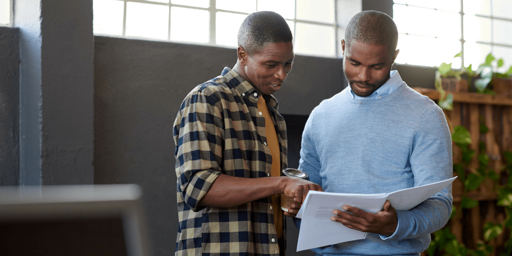 2 Men Reading Reports
